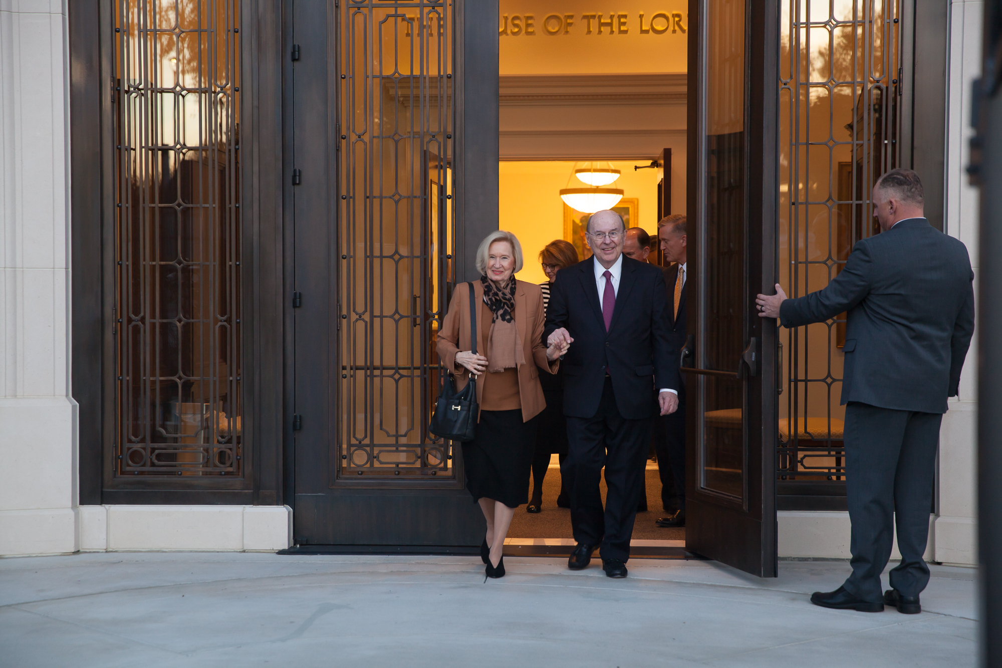 Elder Quentin L. Cook of the Quorum of the Twelve Apostles and his wife, Sister Mary Cook, exit the Baton Rouge Louisiana Temple the evening prior to its rededication on Saturday, Nov. 16, 2019.