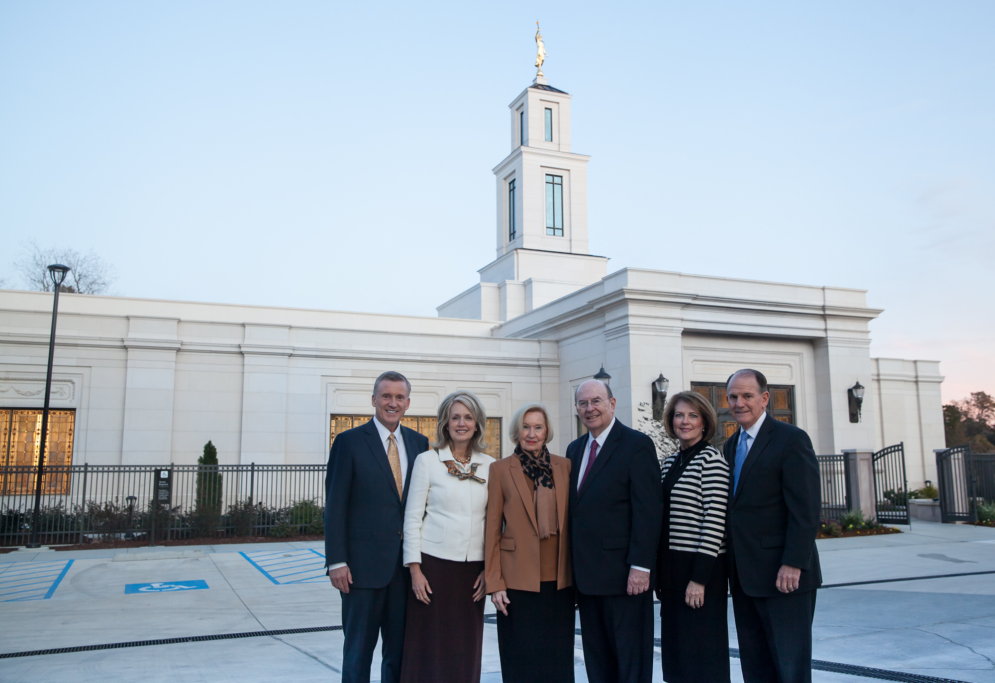 Elder Quentin L. Cook of the Quorum of the Twelve Apostles, center right, stands in front of the Baton Rouge Louisiana Temple with his wife, Sister Mary Cook, center left; Elder Kevin R. Duncan, General Authority Seventy and executive director of the Church's Temple Department, and his wife, Sister Nancy Duncan, left; and Elder James B. Martino, General Authority Seventy and president of the North America Southeast Area, and his wife, Sister Jennie B. Martino, right, on Saturday, Nov. 16, 2019.