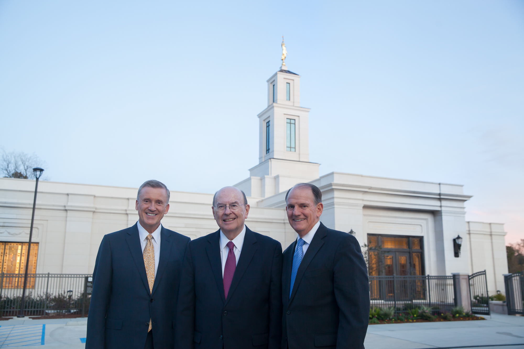 Elder Quentin L. Cook of the Quorum of the Twelve Apostles, center, stands in front of the Baton Rouge Louisiana Temple with Elder Kevin R. Duncan, General Authority Seventy and executive director of the Church's Temple Department, left, and Elder James B. Martino, General Authority Seventy and president of the North America Southeast Area, right, on Saturday, Nov. 16, 2019.