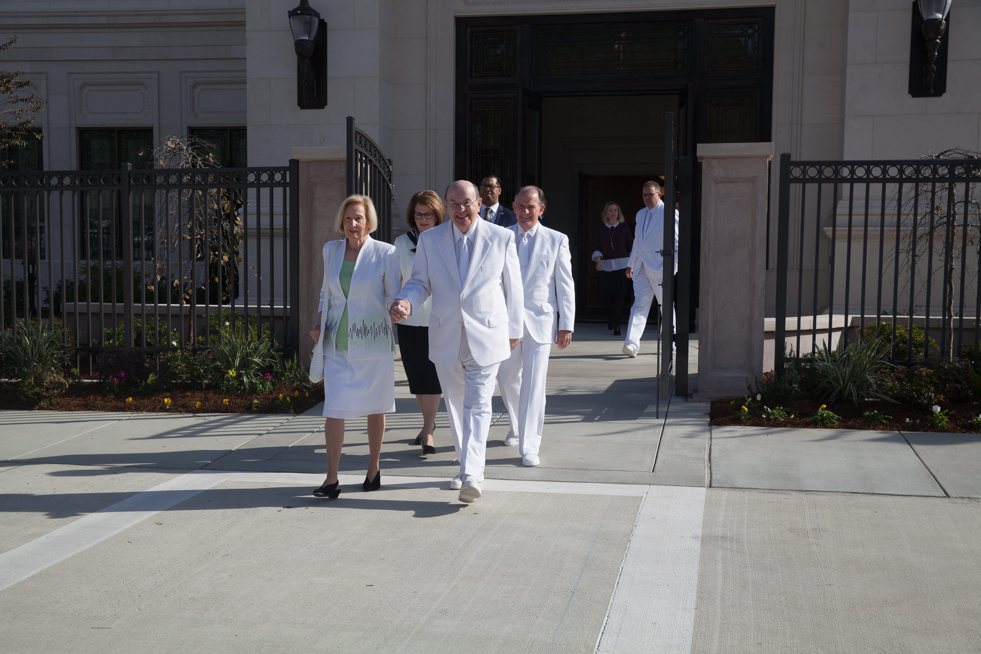 Elder Quentin L. Cook of the Quorum of the Twelve Apostles, and his wife, Sister Mary Cook, exit the Baton Rouge Louisiana Temple prior to its rededication on Sunday, Nov. 17, 2019.