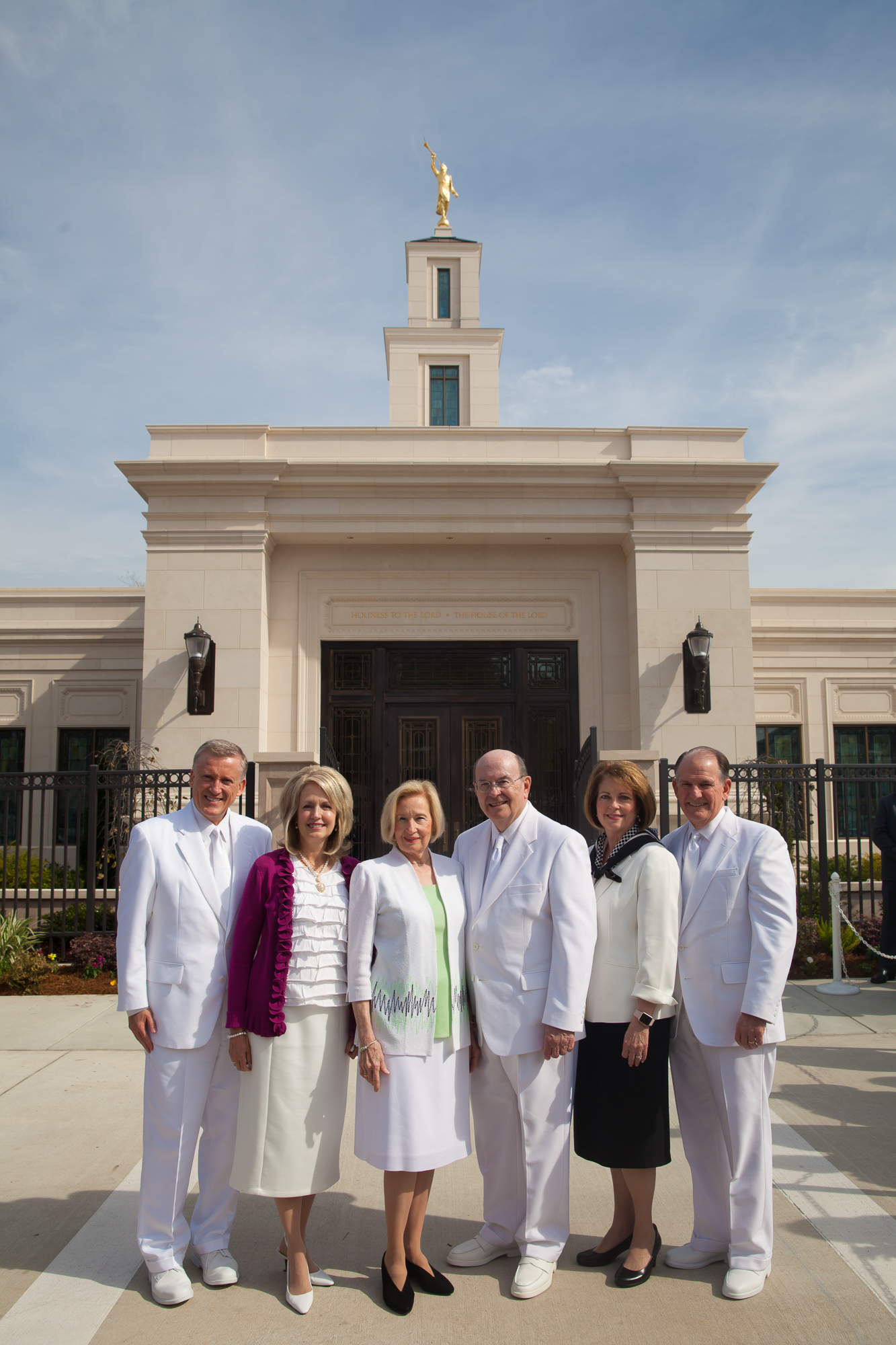 Elder Quentin L. Cook of the Quorum of the Twelve Apostles, center right, stands in front of the Baton Rouge Louisiana Temple with his wife, Sister Mary Cook, center left; Elder Kevin R. Duncan, General Authority Seventy and executive director of the Church's Temple Department, and his wife, Sister Nancy Duncan, left; and Elder James B. Martino, General Authority Seventy and president of the North America Southeast Area, and his wife, Sister Jennie B. Martino, right, on Sunday, Nov. 17, 2019.