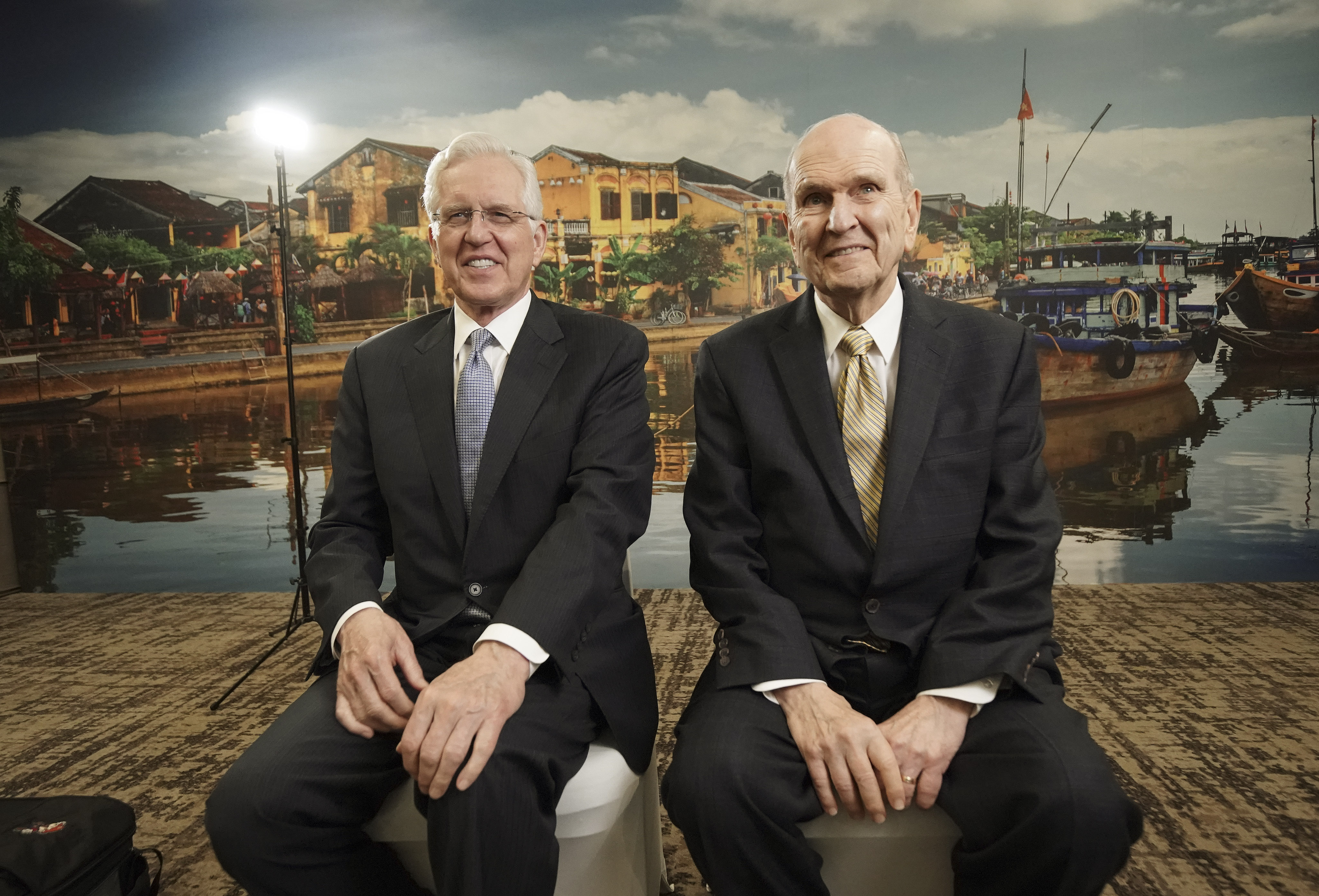 President Russell M. Nelson of The Church of Jesus Christ of Latter-day Saints and Elder D. Todd Christofferson of the Quorum of the Twelve Apostles, laugh prior to an interview in Ho Chi Minh City, Vietnam, on Nov. 18, 2019.
