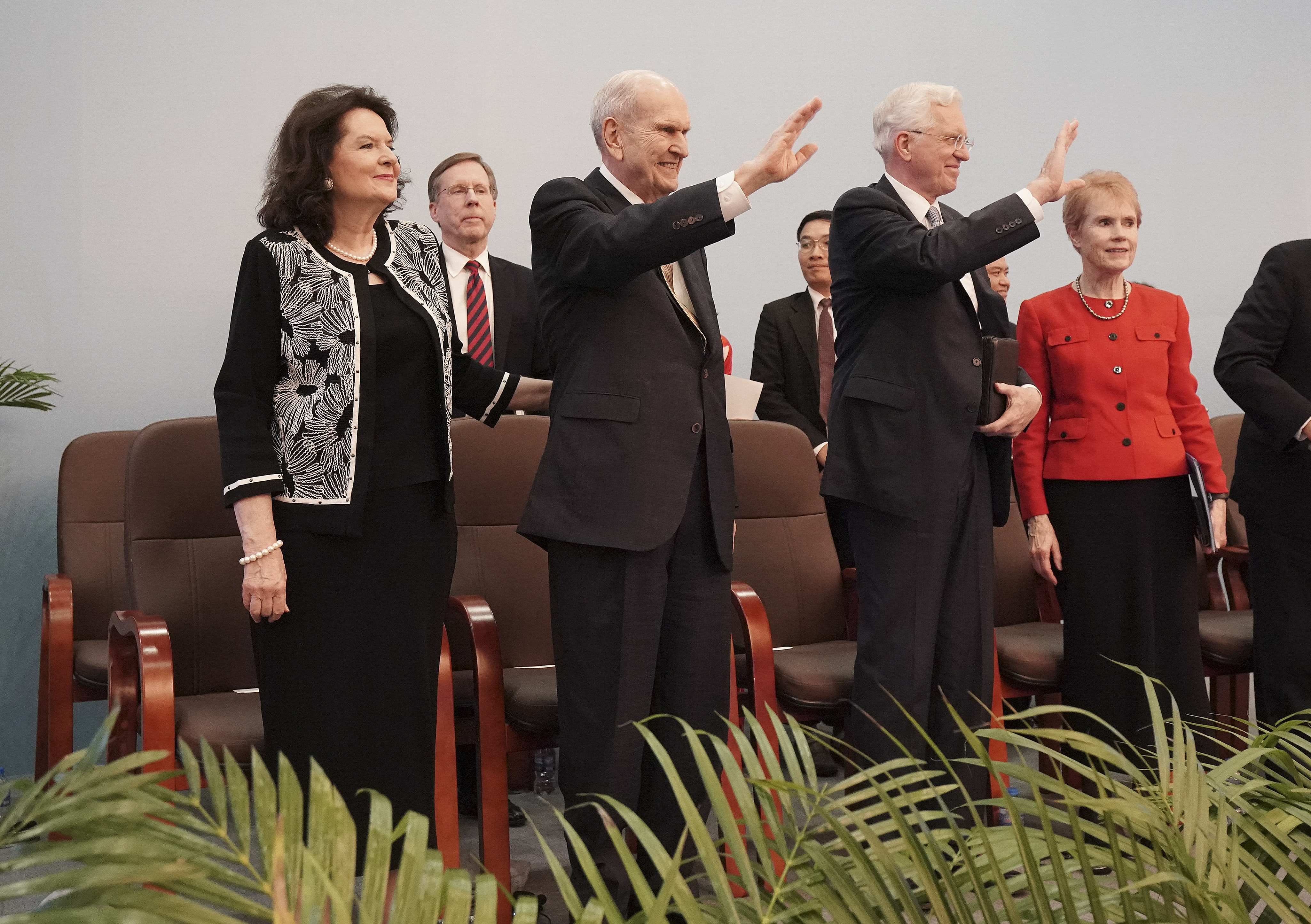 President Russell M. Nelson of The Church of Jesus Christ of Latter-day Saints and his wife, Sister Wendy Nelson, and Elder D. Todd Christofferson of the Twelve Apostles and his wife, Sister Kathy Christofferson, wave after a devotional in Ho Chi Minh City, Vietnam, on Nov. 18, 2019.