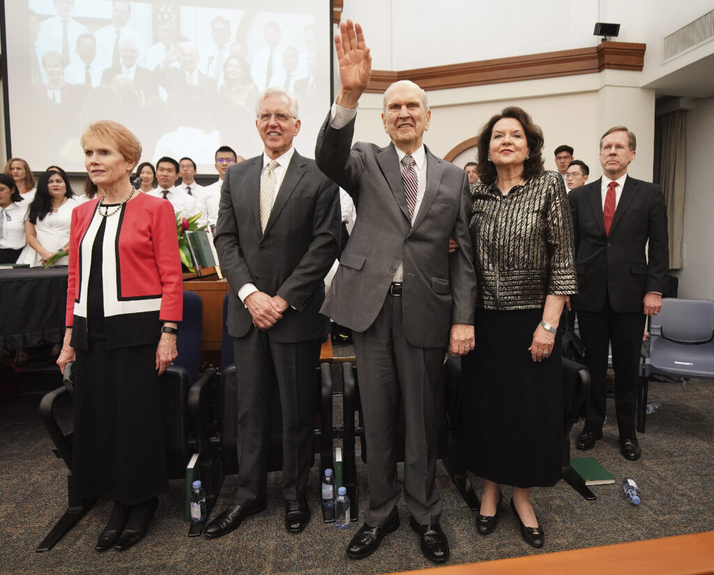 President Russell M. Nelson of The Church of Jesus Christ of Latter-day Saints, and his wife, Sister Wendy Nelson, and Elder D. Todd Christofferson, of The Church of Jesus Christ of Latter-day Saints' Quorum of the Twelve Apostles, and his wife, Sister Sister Katherine Christofferson, wave after a devotional in Singapore on Nov. 20, 2019.