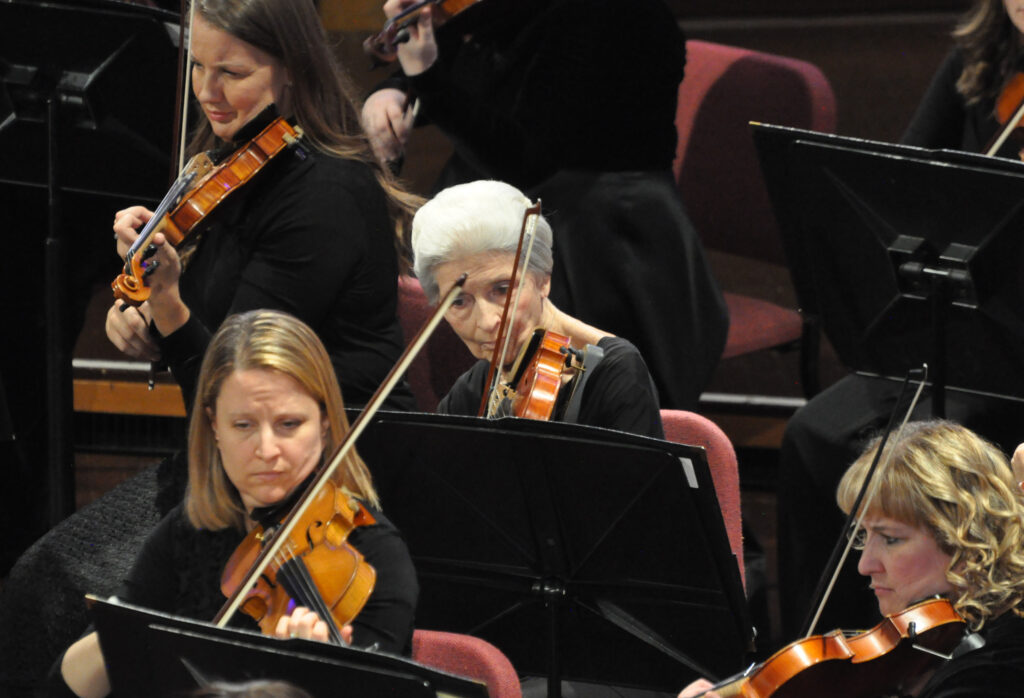 Violinist Marilyn Anderson, center, has performed in the Orchestra at Temple Square since its beginning 20 years ago.