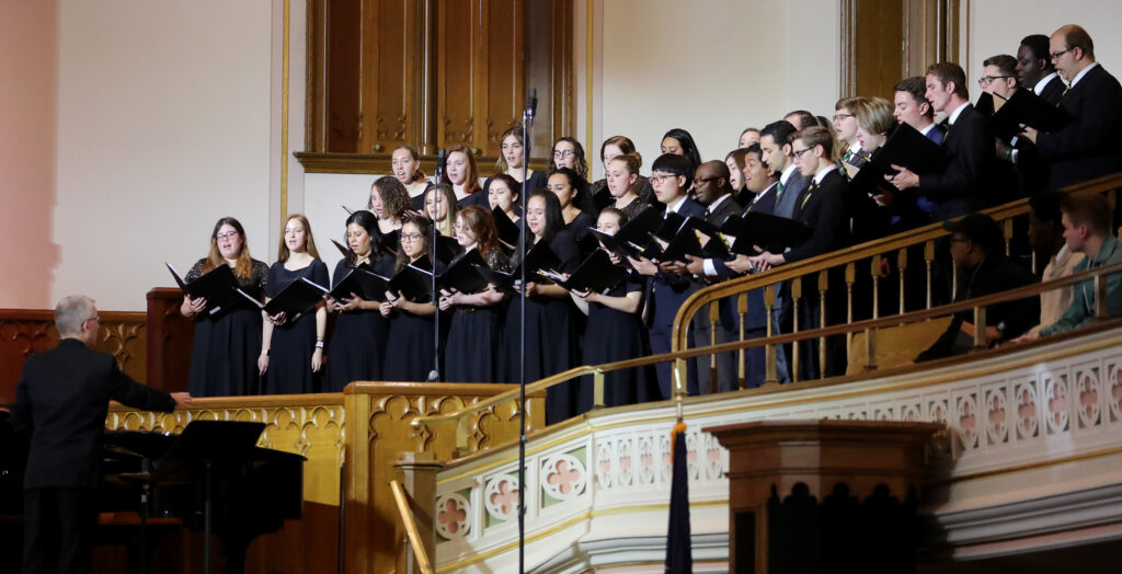The LDSBC Singers perform a musical number prior to Elder Neil L. Andersen speaking at an LDS Business College devotional at the Assembly Hall on Temple Square on Tuesday, Nov. 19, 2019.