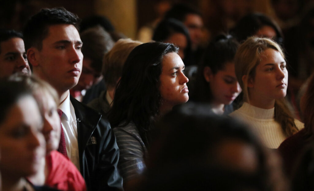 Student listen as Elder Neil L. Andersen speaks at an LDS Business College devotional at the Assembly Hall on Temple Square on Tuesday, Nov. 19, 2019.