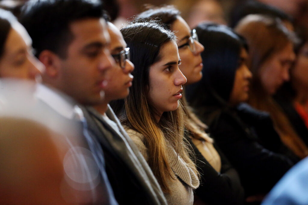 Students listen as Elder Neil L. Andersen speaks at an LDS Business College devotional at the Assembly Hall on Temple Square on Tuesday, Nov. 19, 2019.