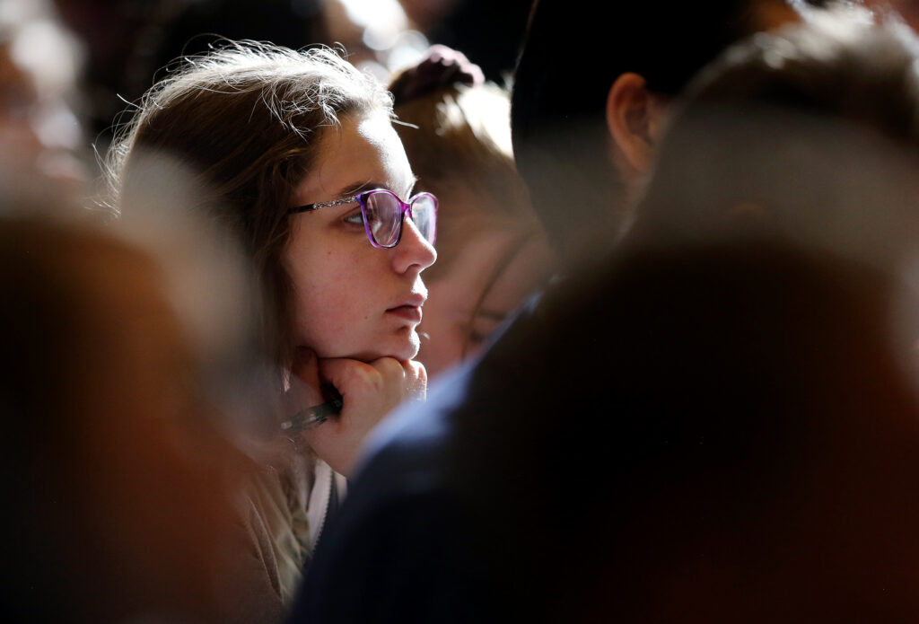 A student listens as Elder Neil L. Andersen speaks at an LDS Business College devotional at the Assembly Hall on Temple Square on Tuesday, Nov. 19, 2019.