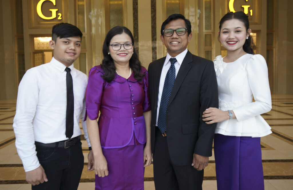 Seag Chen and his wife, Meas Choun, stand with their children, Chhum Kim and Chhum Savatey, in Phnom Penh, Cambodia, on Nov. 19, 2019.