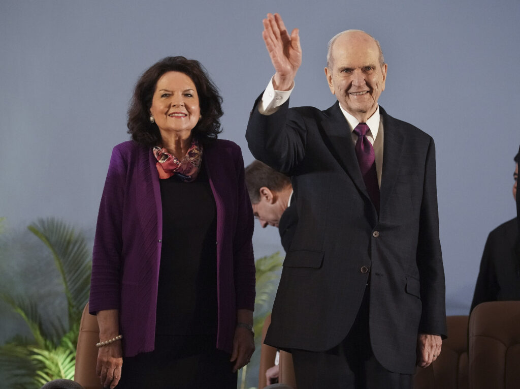 President Russell M. Nelson of The Church of Jesus Christ of Latter-day Saints and his wife, Sister Wendy Nelson, wave to attendees during a devotional in Phnom Penh, Cambodia, on Nov. 19, 2019.