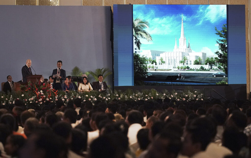 President Russell M. Nelson of The Church of Jesus Christ of Latter-day Saints shows an artist rendering of the Phnom Penh Cambodia temple during a devotional in Phnom Penh, Cambodia, on Nov. 19, 2019.