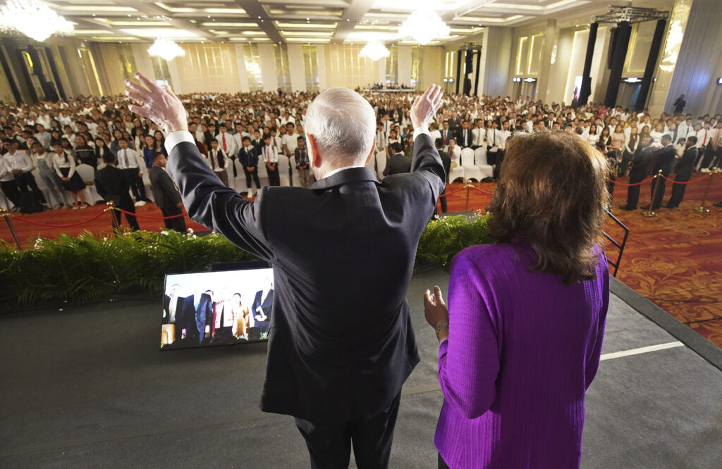 President Russell M. Nelson of The Church of Jesus Christ of Latter-day Saints, and his wife, Sister Wendy Nelson, wave to attendees after a devotional in Phnom Penh, Cambodia, on Nov. 19, 2019.