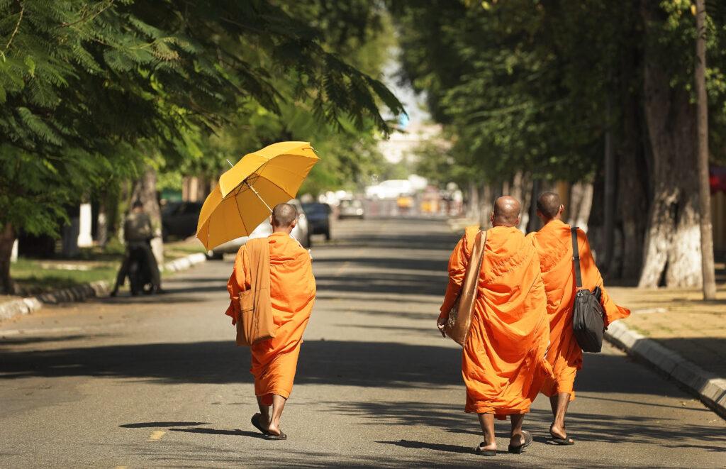 Buddhist monks walk in Phnom Penh, Cambodia, on Nov. 19, 2019.