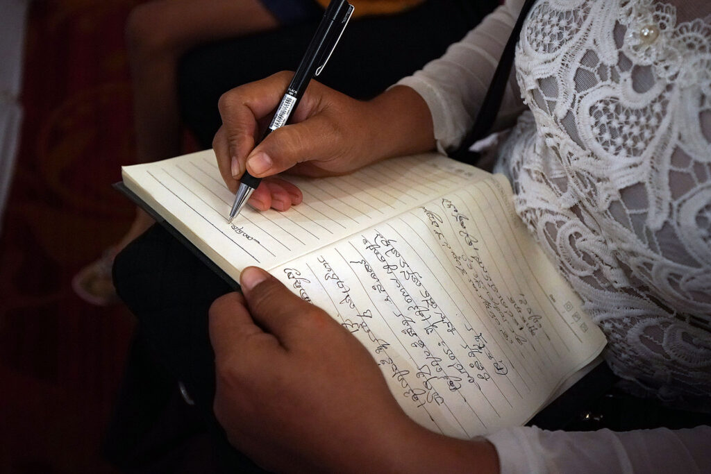 Sam Samith takes notes during a devotional with President Russell M. Nelson of The Church of Jesus Christ of Latter-day Saints in Phnom Penh, Cambodia, on Tuesday, Nov. 19, 2019.