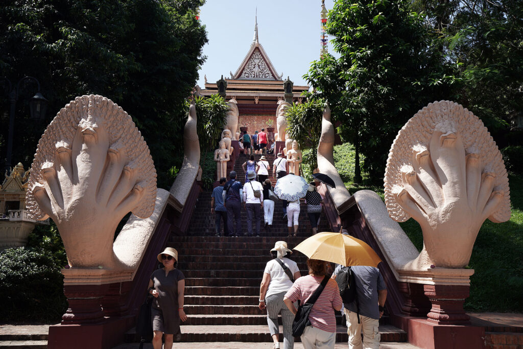 Visitors gather at Wat Phnom, a Buddhist temple in Phnom Penh, Cambodia, on Tuesday, Nov. 19, 2019.