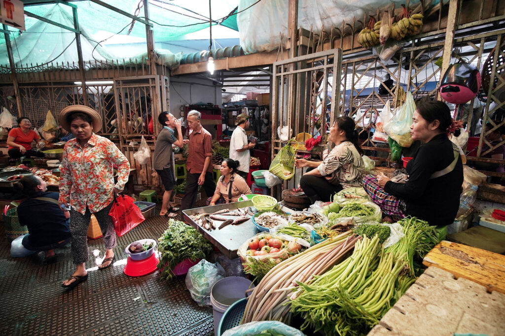 People gather at the central market in Phnom Penh, Cambodia, on Tuesday, Nov. 19, 2019.