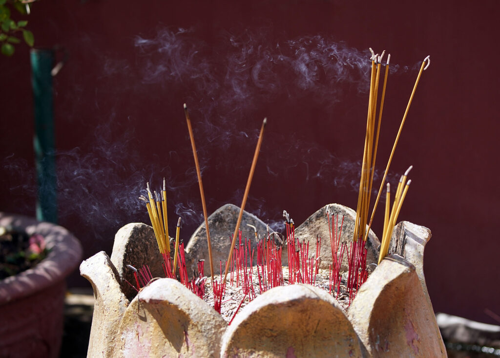 Incense burns at Wat Phnom, a Buddhist temple in Phnom Penh, Cambodia, on Tuesday, Nov. 19, 2019.