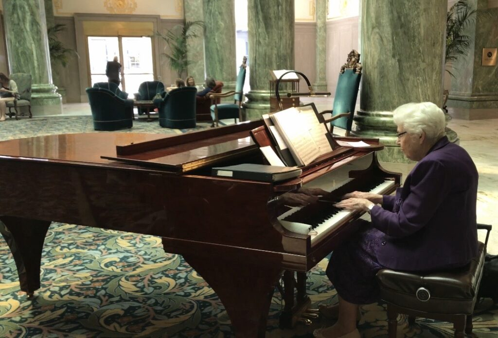 Norma Dee Ryan plays the piano in the lobby of the Joseph Smith Memorial Building in June 2018. After 22 and a half years of playing, Ryan will retire on Monday, Nov. 25.