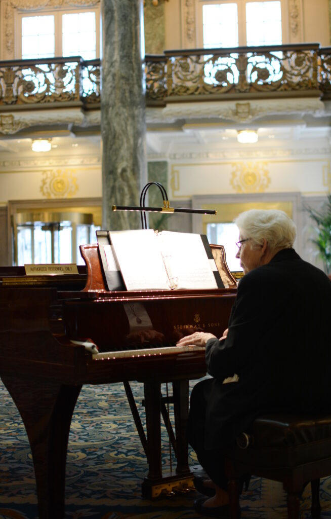 Norma Dee Ryan plays the piano in the lobby of the Joseph Smith Memorial Building in June 2018.