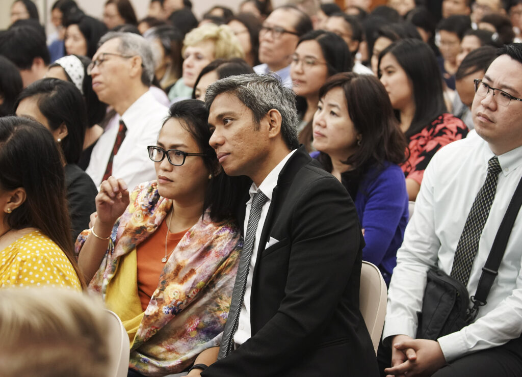 Attendees listen to President Russell M. Nelson of The Church of Jesus Christ of Latter-day Saints during a devotional in Singapore on Nov. 20, 2019.