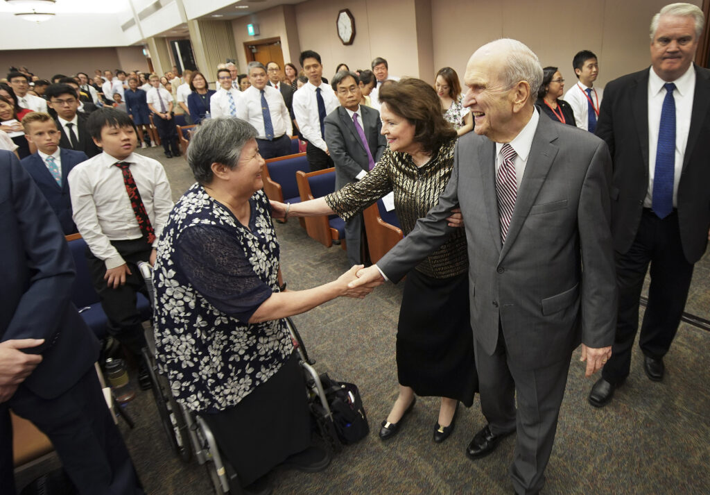 President Russell M. Nelson of The Church of Jesus Christ of Latter-day Saints, and his wife, Sister Wendy Nelson, greet attendees prior to a devotional in Singapore on Nov. 20, 2019.