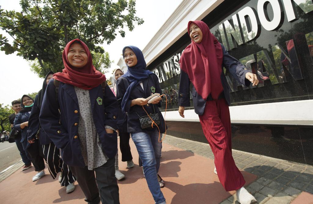 School girls walk in Jakarta, Indonesia, on Nov. 21, 2019.