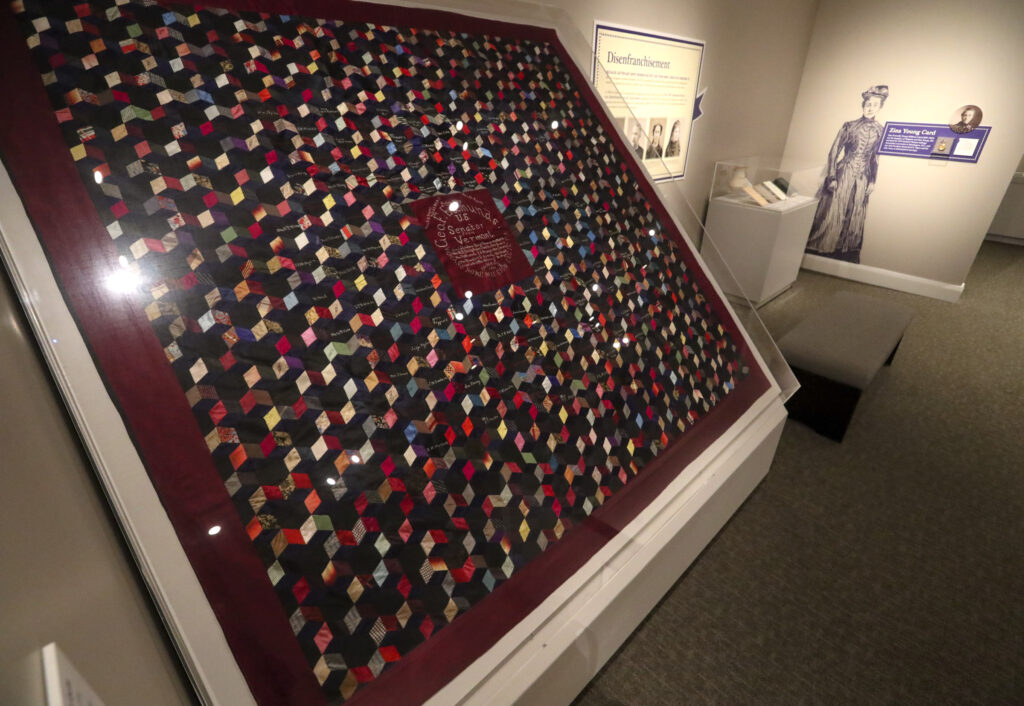 """An Antipolygamy Autograph Quilt is displayed as part of the Church History Museum's new exhibit """"Sisters for Suffrage: How Utah Women Won the Vote"""" in Salt Lake City on Thursday, Nov. 21, 2019. The Women's Home Missionary Society was a Methodist organization that supported the 1882 Edmunds Act, which, among other things, took the right to vote away from polygamous men and women. To show their gratitude for the new law the society members gathered signatures from across the country and assembled the quilt for the bill's sponsor, Vermont Sen. George F. Edmunds."""