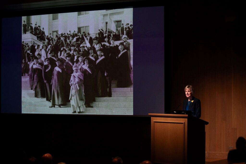 "Sister Jean B. Bingham, Relief Society general president, speaks at the ""Sisters for Suffrage: How Utah Women Won the Vote,"" exhibit's opening night at the Church History Museum on Nov. 21, 2019, in Salt Lake City, Utah. Sister Bingham spoke of Latter-day Saint women's role in the Utah and national suffragist movement."