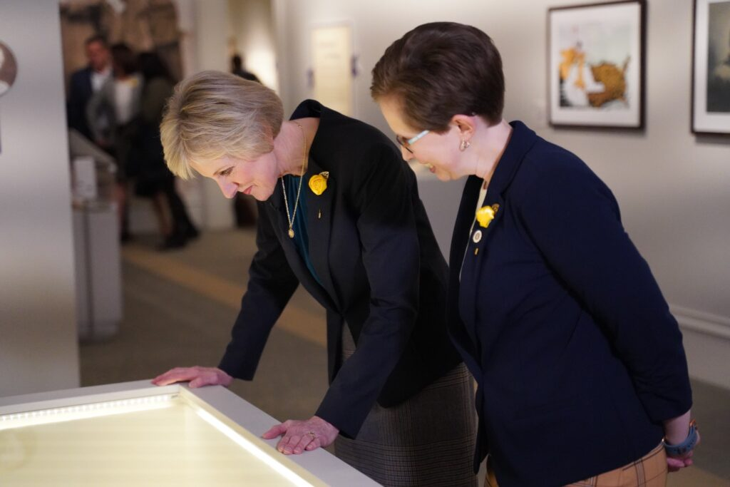 "Sister Jean B. Bingham, Relief Society general president, tours the Church History Museum's newest exhibit, ""Sisters for Suffrage: How Utah Women Won the Vote,"" with Church History Museum Educator Tiffany Bowles on Nov. 21, 2019, in Salt Lake City, Utah."