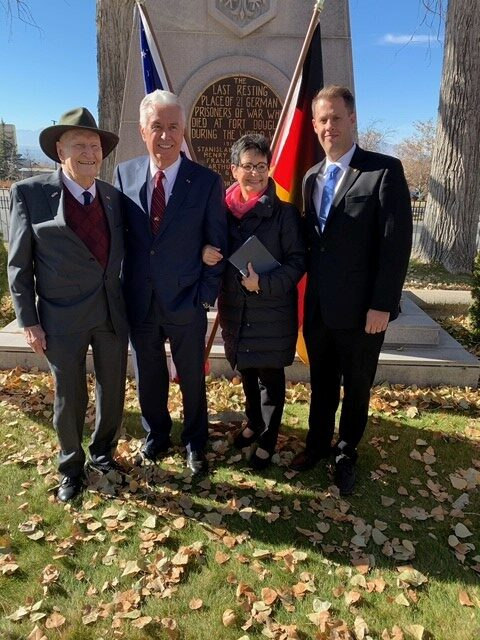 'Candy Bomber' Gail Halvorsen, Elder Dieter F. Uchtdorf of the Quorum of the Twelve Apostles, Sister Harriet Uchtdorf and James Burton, honorary consul to Germany, pose for a photo in front of the memorial to German soldiers who died in Utah following the Volkstrauertag commemoration event held in Fort Douglas Military Cemetery on Sunday, Nov. 17, 2019.