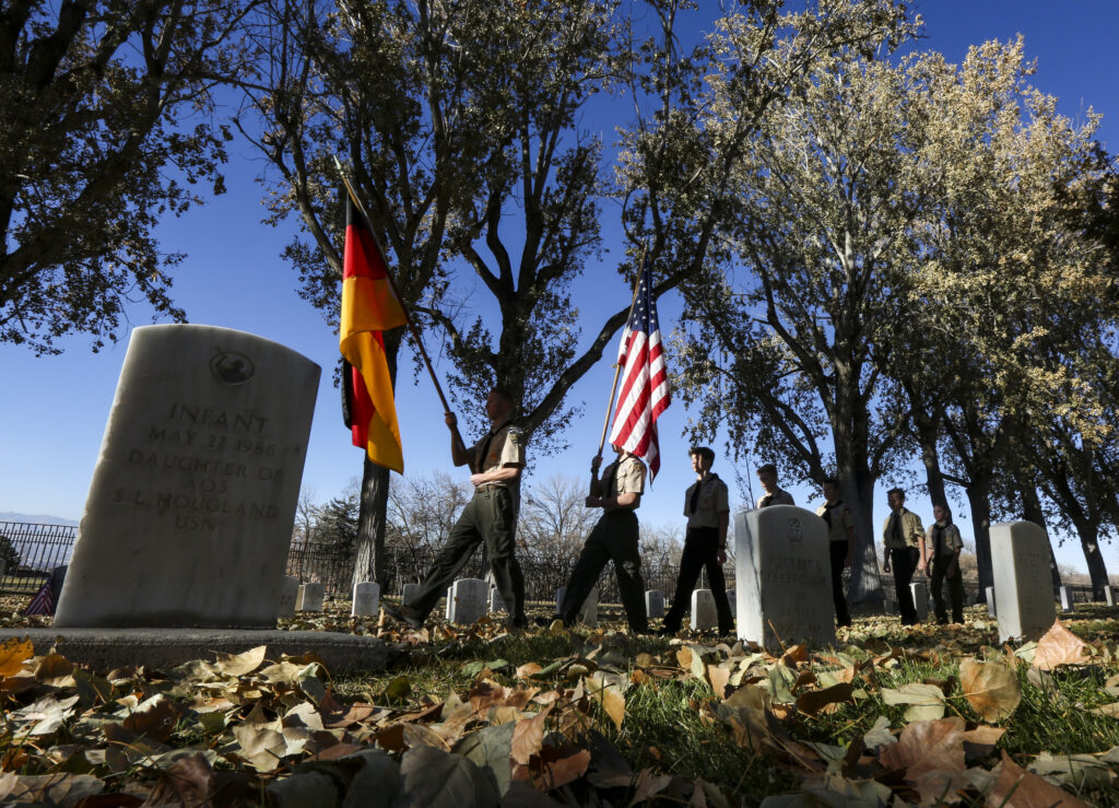 Boy Scout Troop 596 performs color guard duties during the Volkstrauertag ceremony at the Fort Douglas Military Cemetery in Salt Lake City on Sunday, Nov. 17, 2019. Volkstrauertag is the German National Day of Remembrance where the German people honor those that have fall in the line of duty as well as those that were victims of the government. Fort Douglas Military Cemetery is the final resting place of several German prisoners of war that never made it back to Germany.