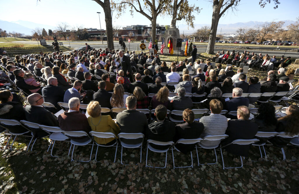 Several hundred people fill the chairs and stand among the headstones during the Volkstrauertag ceremony at the Fort Douglas Military Cemetery in Salt Lake City on Sunday, Nov. 17, 2019. Volkstrauertag is the German National Day of Remembrance where the German people honor those that have fall in the line of duty as well as those that were victims of the government. Fort Douglas Military Cemetery is the final resting place of several German prisoners of war that never made it back to Germany.