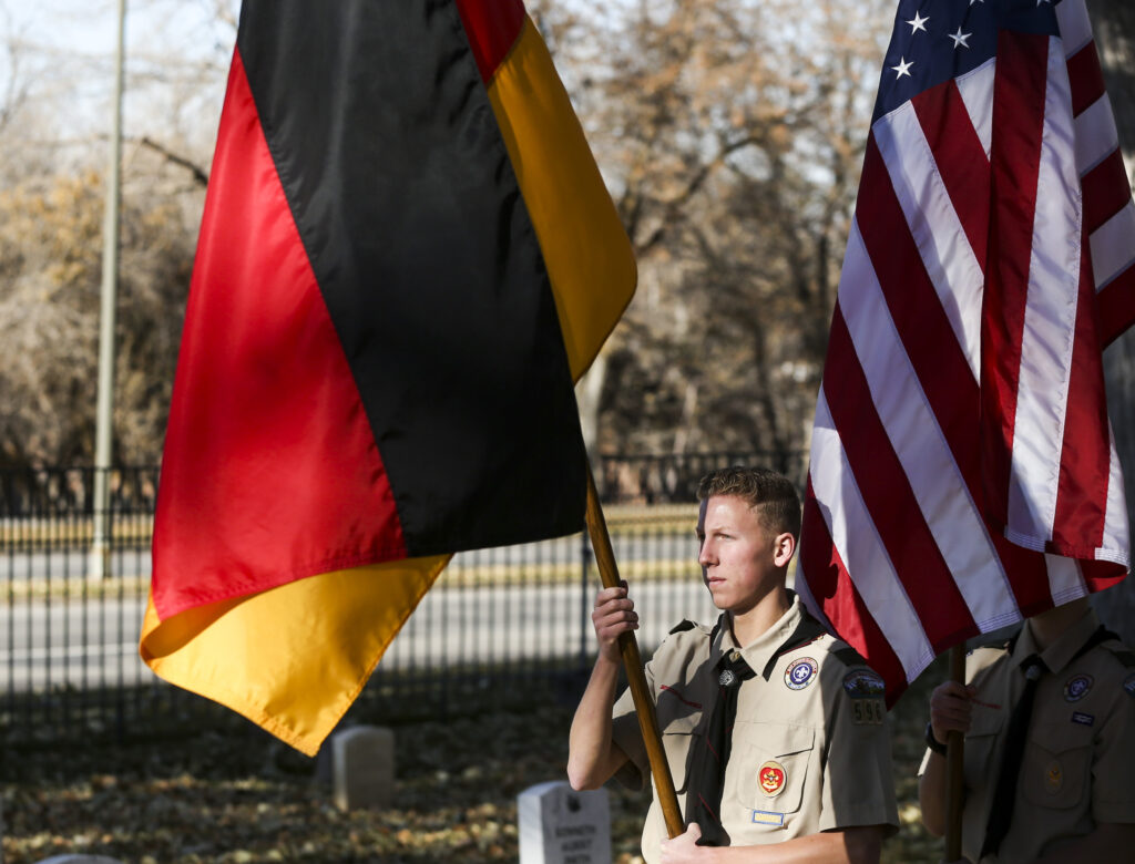 Josh Taggart, 17, with Boy Scout Troop 596, bears the German flag at the lead of the color guard during the Volkstrauertag ceremony at the Fort Douglas Military Cemetery in Salt Lake City on Sunday, Nov. 17, 2019. Volkstrauertag is the German National Day of Remembrance where the German people honor those that have fall in the line of duty as well as those that were victims of the government. Fort Douglas Military Cemetery is the final resting place of several German prisoners of war that never made it back to Germany.