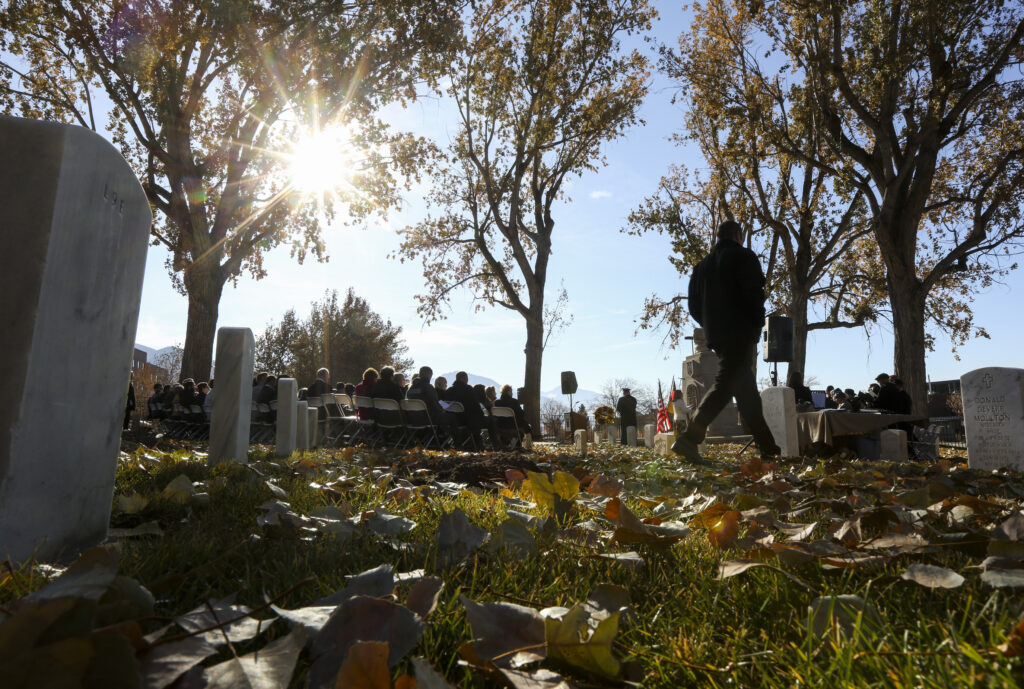 A man walks through the headstones at the start of the Volkstrauertag ceremony at the Fort Douglas Military Cemetery in Salt Lake City on Sunday, Nov. 17, 2019. Volkstrauertag is the German National Day of Remembrance where the German people honor those that have fall in the line of duty as well as those that were victims of the government. Fort Douglas Military Cemetery is the final resting place of several German prisoners of war that never made it back to Germany.
