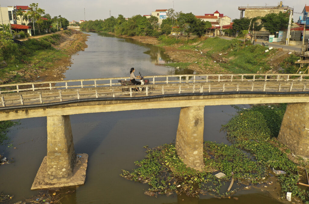 A motorist travels across a bridge in Hanoi, Vietnam, on Saturday, Nov. 16, 2019.