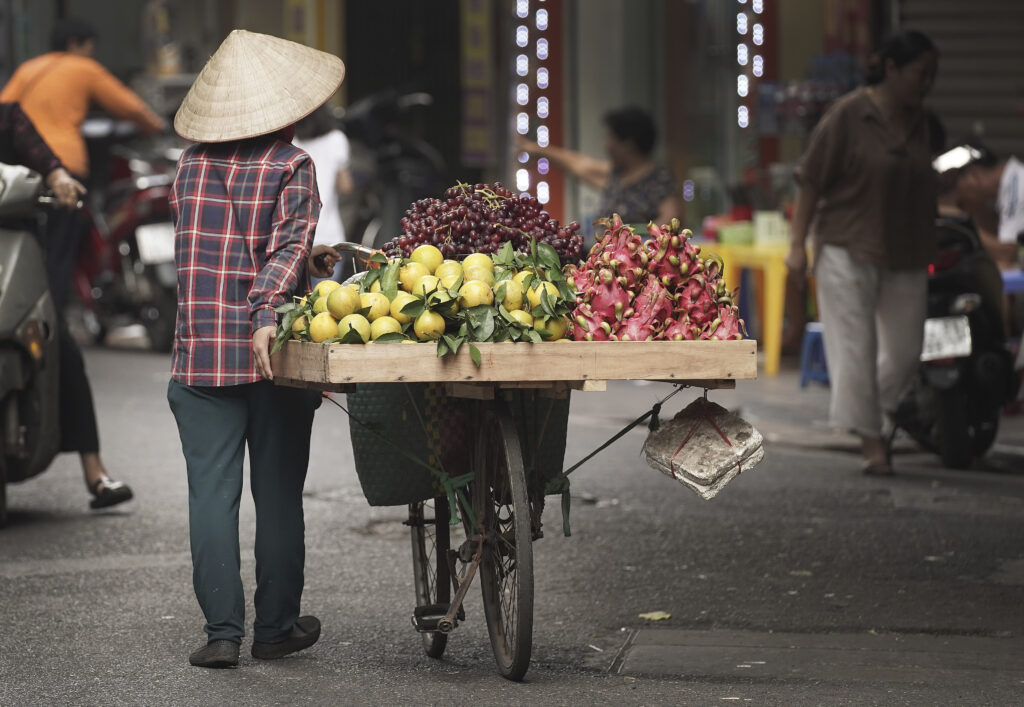 A woman sells produce in Hanoi, Vietnam, on Sunday, Nov. 17, 2019.