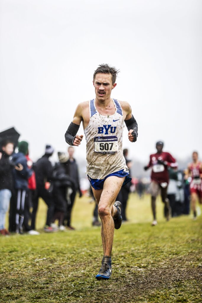 BYU distance runner Conner Mantz runs in wet, muddy conditions at the Nov. 23, 2019, NCAA Championships in Indiana.