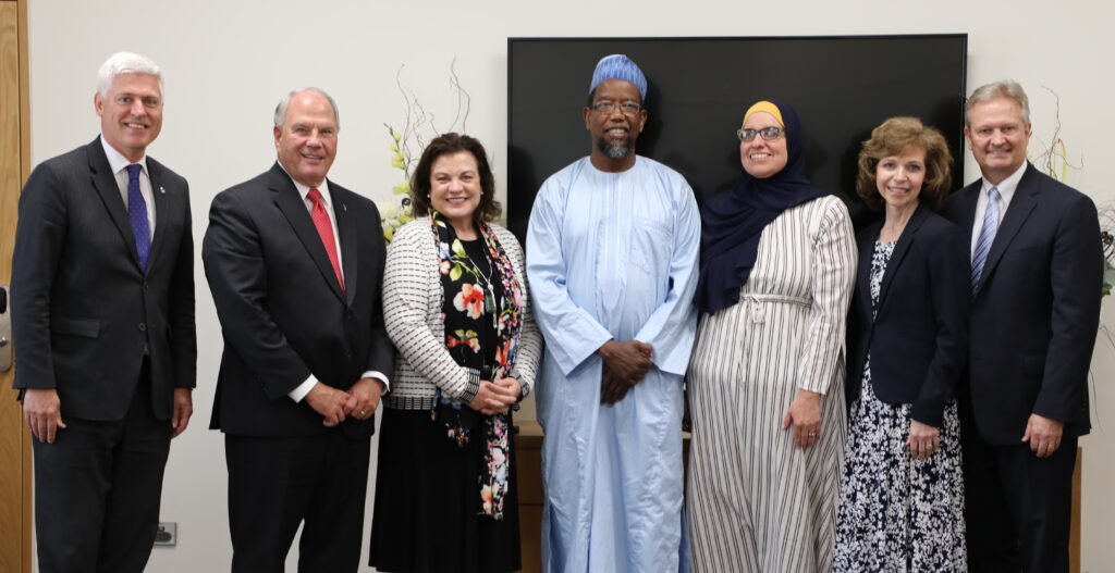 Elder Ronald A. Rasband and Sister Melanie Rasband;, second and third from left, meet with Tim Macindoe, member of New Zealand's Parliament, left; Dr. Mustafa Farouk, center, president of the Federation of Islamic Associations of New Zealand, and his wife, Bilkisu Farouk; and Sister Shawna Nattress, second from right; and Elder K. Brent Nattress, a General Authority Seventy and Pacific Area presidency counselor. The group met in Hamilton, New Zealand, on Nov. 16, 2019.
