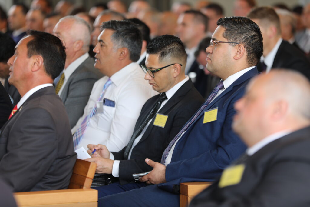 Men listen and take notes during the Nov. 16, 2019, Priesthood Leadership Conference held in Hamilton, New Zealand, with Elder Ronald A. Rasband presiding.