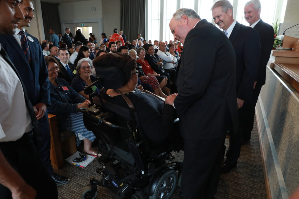 Elder Ronald A. Rasband greets a member as part of a Nov. 16, 2019, Leadership Conference with ward and stake leaders in Hamilton, New Zealand.