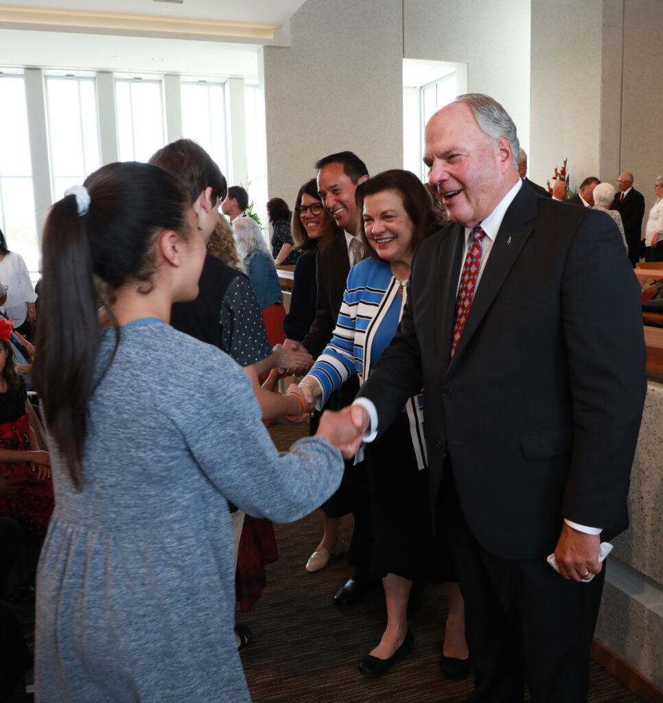 Elder Ronald A. Rasband, right, and Sister Melanie Rasband, greet members of the Temple View New Zealand Stake following a Nov. 17, 2019, stake conference in Hamilton, New Zealand.