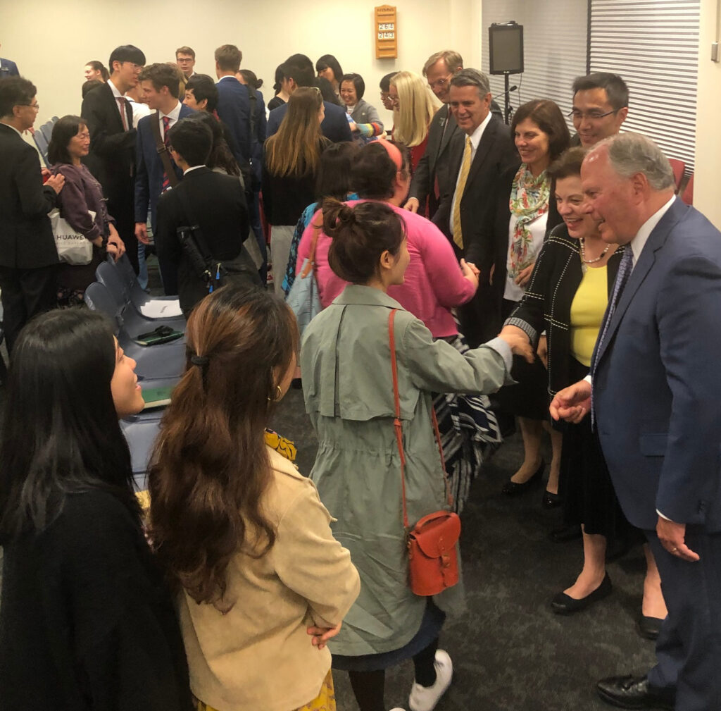 Elder Ronald A. Rasband, right, and his wife, Sister Melanie Rasband, join branch and area leaders and spouses in greeting members of the Melbourne 1st (Mandarin) Branch following a Nov. 18, 2019, devotional in Melbourne, Australia.