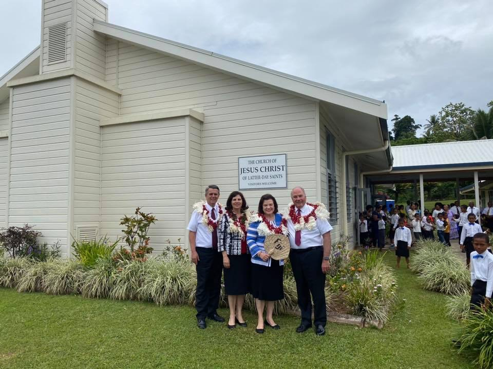 Elder Ronald A. Rasband, right, and his wife, Sister Melanie Rasband, second from right, pause for a photo with Elder Ian S. Ardern, left, president of the Pacific Area, and his wife, Sister Paula Ardern, outside the Taveuni meetinghouse in Fiji on Nov. 24, 2019.