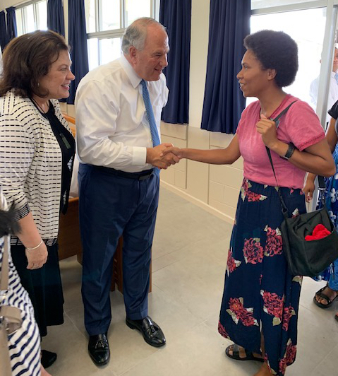 Sister Melanie Rasband and Elder Ronald A. Rasband greet a missionary at the Nov 21, 2019, devotional with the Fiji Suva Mission.