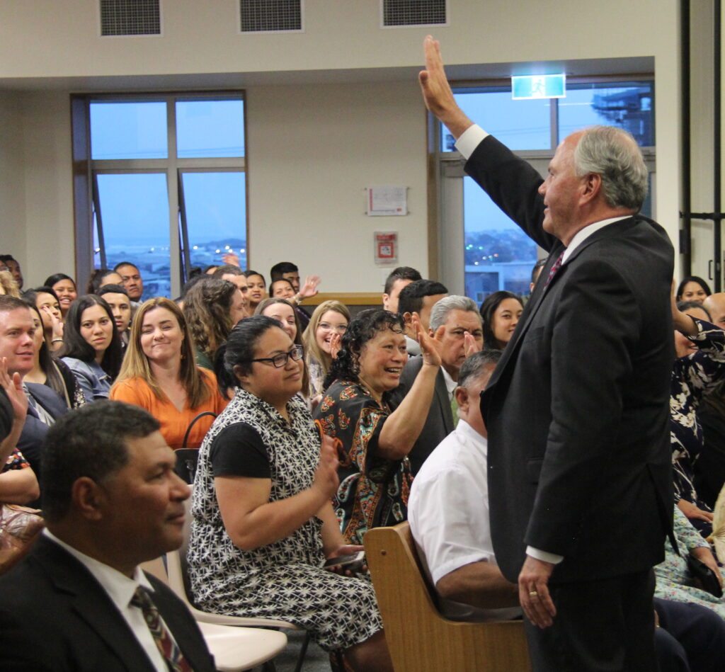 Elder Ronald A. Rasband waves to young single adults after speaking at a Nov. 17, 2019, devotional in Auckland, New Zealand.