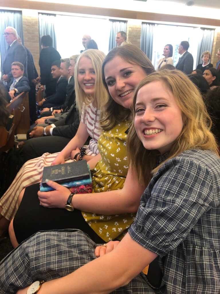 Sister missionaries of the Australia Melbourne Mission await the start of a Nov. 18, 2019, devotional with Elder Ronald A. Rasband in Melbourne, Australia.