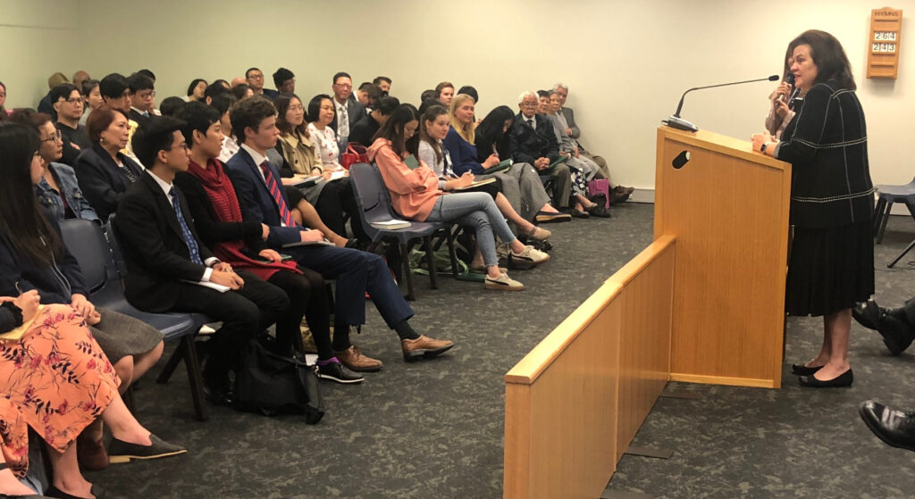 Sister Melanie Rasband, wife of Elder Ronald A. Rasband, speaks to members of the Melbourne 1st (Mandarin) Branch during a Nov. 18, 2019, devotional.