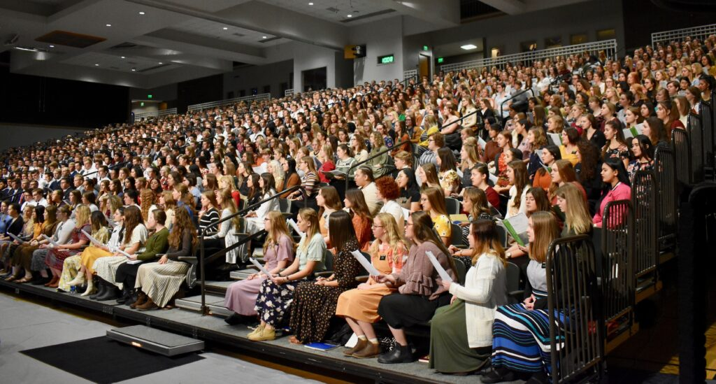 The Provo Missionary Training Center choir sings during a Nov. 28, 2019, Thanksgiving Day devotional with Elder Neil L. Andersen in Provo, Utah.