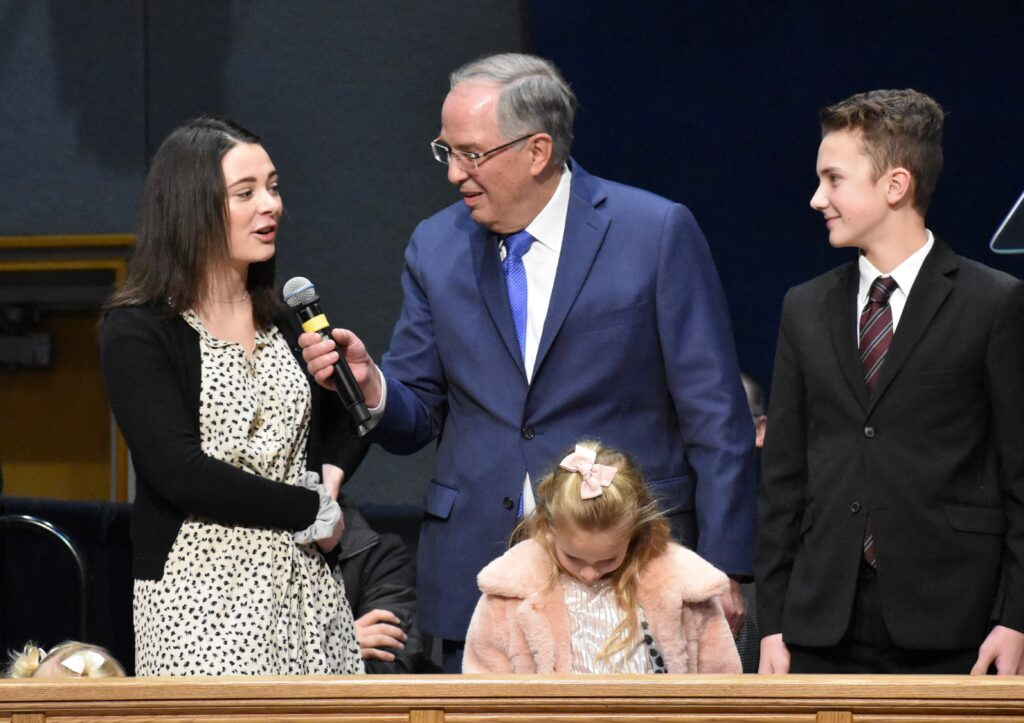 Elder Neil L. Andersen asks questions of several of his grandchildren during a Thanksgiving Day devotional at the Provo Missionary Training Center on Nov. 28, 2019, in Provo, Utah.